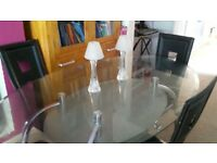 glass top dining table and 4 black chairs