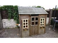 Wooden playhouse in need of TLC