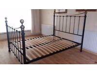 Beautiful black king size metal bed. Delivery can be arranged if required.