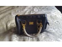 Genuine Gianni Versace Handbag. Wife received this as a gift, never used