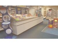 Full shop fittings/shelves/ 17ft counter/ till/ newspaper stand/ magazine racking/ card stands