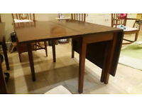Beautiful dining table seating around 10 and folds
