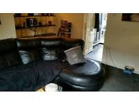 Corner sofa with recliner at one end. Excellent condition no rips marks.