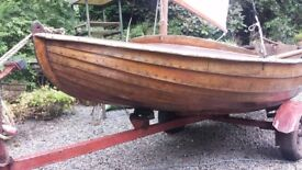 Clinker built wooden sailing boat and road trailer.