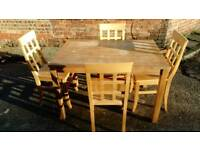 DINING TABLE AND 4 CHAIRS GOOD CONDITION BUT TABLE TOP NEEDS PAINTING /VARNISHING