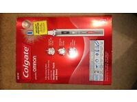 Colgate ProClinical C600 electric toothbrush WITH NEW SEALED BRUSH HEAD