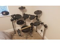 Alessis Forge Drum set w/ headphones, throne and sticks.