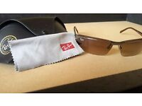 Ray Ban sunglasses as good as new --- black leather case and cleaning cloth included