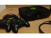 XBOX plus 18 games and two controllers