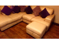 LEATHER CORNER SOFA WITH OPEN MATCHING STORAGE POUFEE IN A LOVELY SANDY BEIGE COLOUR SEE BELOW