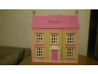 DOLLS HOUSE WITH NAME 'MEGAN' ON ROOF