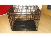 One new and one hardly used dog cages for sale.