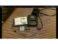 Finepix f50 fd 12.0 mega pixel camera with charger battery and 8gb memory card
