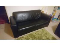 2 Black Leather 3 seater sofas. Free to collecter. Shoreham by Sea