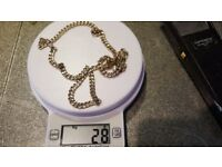 """18ct gold chain.24"""".28 grams.hall marked 750."""