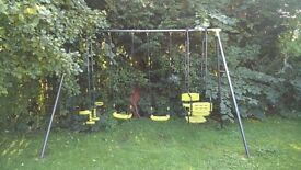 Large Garden swing set, 2 swings, one glider swing and one gondola double chair swing.