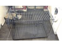 "A LARGE DOG CAGE 36""W 24""H AND 22""D"