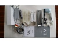 Nintendo console, with 2 controllers, nunchuck, instructions, cables