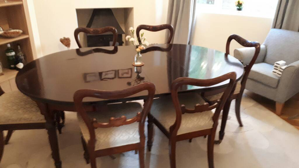 Antique mahogany dining table and six rosewood chairs