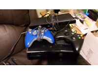 XBOX 360 with kinnect both wired and wireless controller and 35 games. Excellent condition