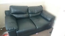 2 x black sofas