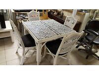 White Wicker Dining Table With Covered Glass Top in Good Condition With Four Chairs