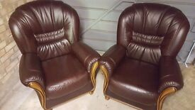 Two Brown Leather Armchairs