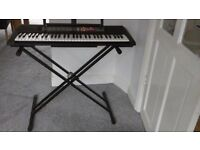 Yamaha PSR F50 portable digital keyboard with Tiger double keyboard stand & manual & AC adaptor.