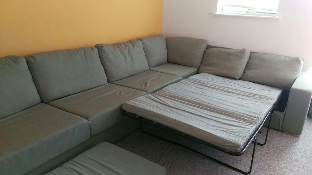 Large Corner Sofa In Olive Green And Fold Out Bed