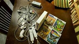 Nintendo wii 2 controllers and 4 games