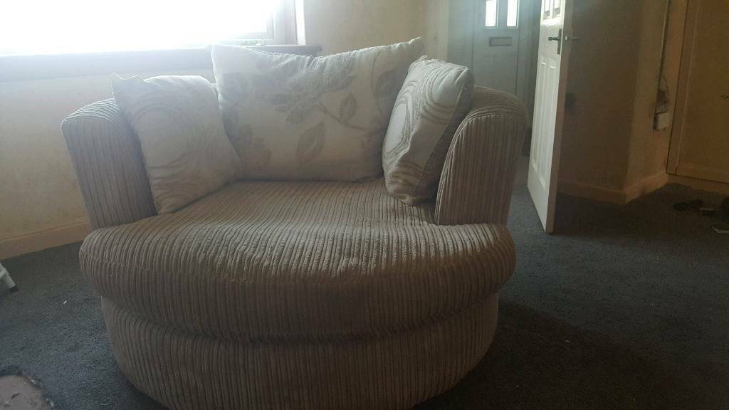 Cream swivel cuddler chair and 2 seater couch