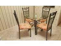 Glass dining table and chairs set
