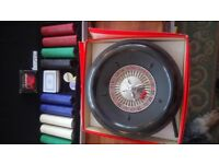 Roulette wheel and Chips/dice/cards in metal case hardly used