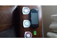Psp with 1.0gb memory card and 3 games NO CHARGER