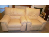Pair of two light pale canary yellow comfortable leather armchairs recliner chair