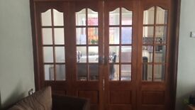 Set of 4 wooden glazed internal folding doors and matching wooden glazed single door £100 ono