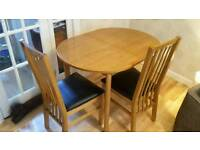 Extended dining table and 2 black faux leather chairs. Collection only.