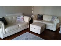 Two Leather Chesterfield Sofas and Footstool