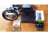 XBOX 360 slim package including kinect, 2 wireless controls, mad catz steering wheel & 9 games