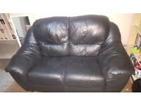 2 seater black leather effect sofa