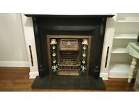 Cast iron tiled fireplace and wood surround