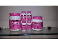 Selection of vitamins and fitness supplements including gloves and dipping belts.