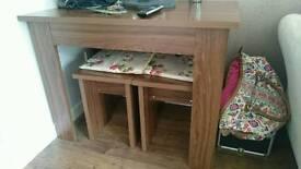 Dark wood space saving table