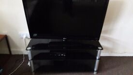 LG lcd tv 42 inch with black glassy stand for sale