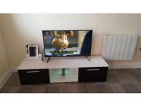 panasonic tv and cabinet
