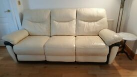 Cream 3 seat leather sofa with power reclining mechanism for sale at £139 in Porthcawl