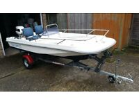 Boat with Trailer and 50HP 2 Stroke Outboard - Ready to go.