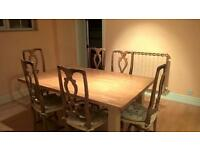 Ash block table and seven solid oak chairs with soft wicker seats