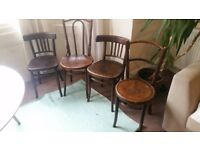 4 different dark wood dining chairs