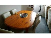 Solid pine 6 seater dining table and chairs